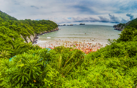 overcrowded: overcrowded beach in Cat Ba Island - it is a popular summer destination for Vietnamese tourists Stock Photo