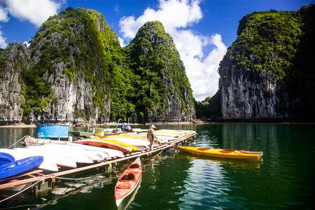 cruising among beautiful limestone rocks and secluded beaches in Ha Long bay, Vietnam.