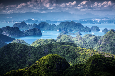 scenic view over Ha Long bay from Cat Ba island, Ha Long city in the background,  Vietnam Stock Photo
