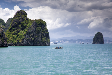cruising among beautiful limestone rocks and secluded beaches in Ha Long bay, Vietnam Stock Photo