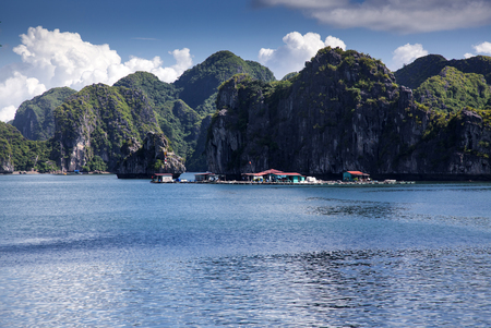 secluded: cruising among beautiful limestone rocks and secluded beaches in Ha Long bay, Vietnam Stock Photo