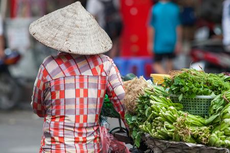 sell: street vendors selling their goods in Hanoi, Vietnam Stock Photo
