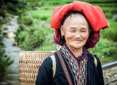 SA PA, VIETNAM - AUGUST 2017: Portrait of Red dzao ethnic minority woman in Ta Phin village, Sa Pa, Lao Cai province, Vietnam