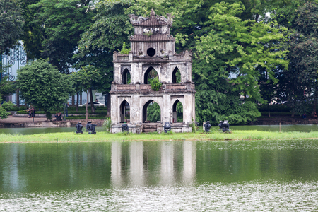 view of the Turtle Tower in middle of the Hoan Kiem Lake (Lake of the Returned Sword) at historic centre of Hanoi in Vietnam Stock Photo