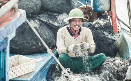 local 27: NAM DU, VIETNAM - JULY 27, 2017: Local fishermen working on their boats in Hon Tre pier, early morning, Nam Du Islands, Kien Giang, Vietnam