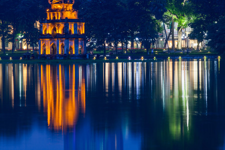 night view of the Turtle Tower in middle of the Hoan Kiem Lake (Lake of the Returned Sword) at historic centre of Hanoi in Vietnam Stock Photo