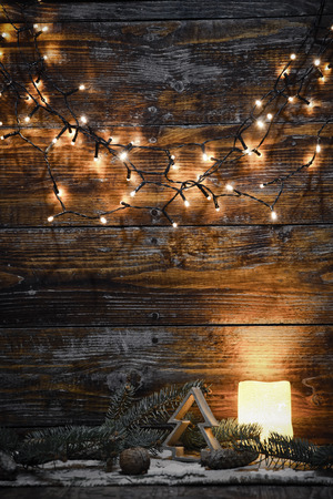 christmas decorations and lights on wooden background Zdjęcie Seryjne - 89326038