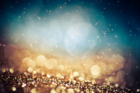 abstract Christmas background with holiday lights and copy space - magic bokeh glitter with blinking stars and falling snowflakes