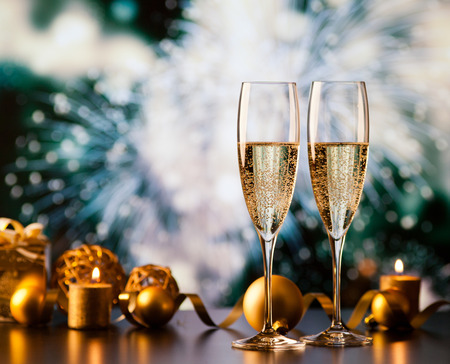 two champagne glasses against holiday lights and fireworks - new year celebration Stok Fotoğraf - 89395202