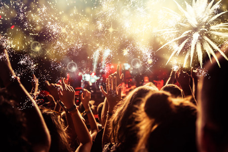 new Year concept - cheering crowd and fireworks Stockfoto