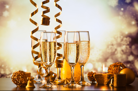 fizz: champagne glasses against holiday lights ready for New Years eve party Stock Photo