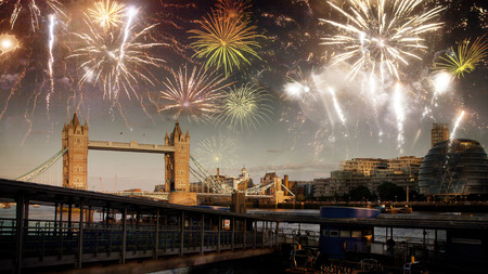 explosive fireworks display fills the sky around Big Ben. New Years Eve celebration in the city