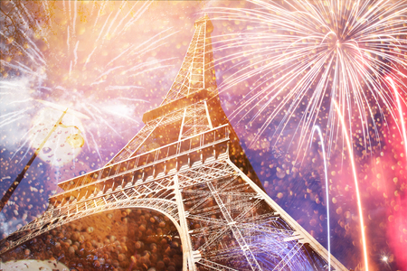 celebrating New Year in the city - Eiffel tower (Paris, France) with fireworks