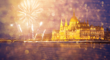 celebrating New Year in the city - Budapest parliament with fireworks, Hungary Stock Photo