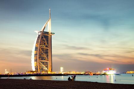 DUBAI, UAE - FEBRUARY 2018 :The world's first seven stars luxury hotel Burj Al Arab at night seen from Jumeirah public beach in Dubai, United Arab Emirates Editoriali