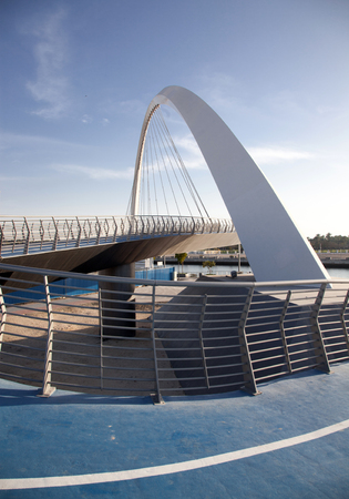 DUBAI, UAE - FEBRUARY, 2018: Dubai Water Canal arch bridge or Tolerance bridge Editorial