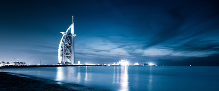 DUBAI, UAE - FEBRUARY 2018 :The world's first seven stars luxury hotel Burj Al Arab at night seen from Jumeirah public beach in Dubai, United Arab Emirates 에디토리얼