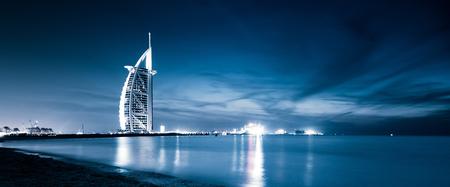 DUBAI, UAE - FEBRUARY 2018 :The world's first seven stars luxury hotel Burj Al Arab at night seen from Jumeirah public beach in Dubai, United Arab Emirates Éditoriale