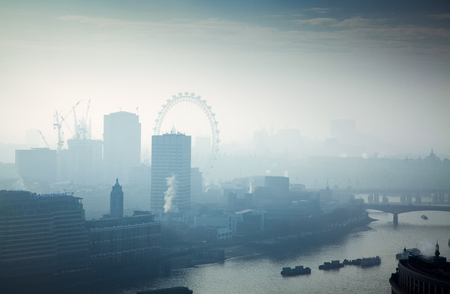 rooftop view over London on a foggy day from St Paul's cathedral, UK Фото со стока - 97432573