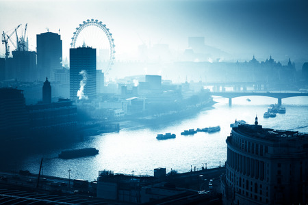 rooftop view over London on a foggy day from St Paul's cathedral, UK