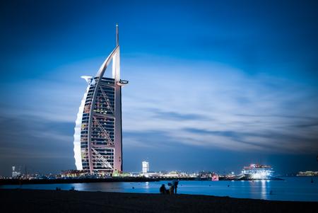 DUBAI, UAE - FEBRUARY 2018 :The world's first seven stars luxury hotel Burj Al Arab at night seen from Jumeirah public beach in Dubai, United Arab Emirates 報道画像