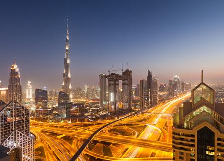 DUBAI, UAE - FEBRUARY 2018: Dubai skyline at sunset with Burj Khalifa, the world tallest building and Sheikh Zayed road traffic