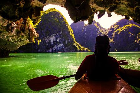 kayaking among caves and lagoon in Ha Long bay, Vietnam