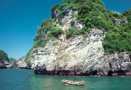 boats among beautiful limestone rocks of Lan Ha bay, the twin of Ha Long bay ona sunny day, Vietnam Editorial