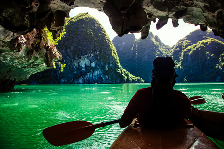 kayaking among caves and lagoon in Ha Long bay Imagens