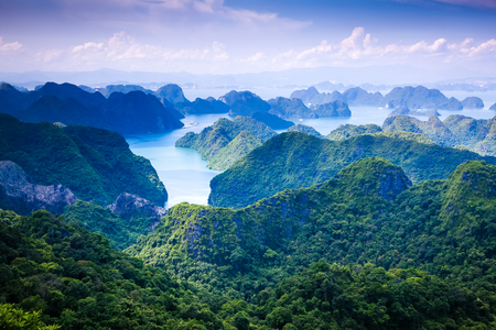 scenic view over Ha Long bay from Cat Ba island, Ha Long city in the background, Vietnam