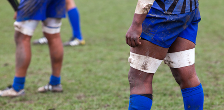 rugby player preparing to kick the oval ball during game Stock Photo