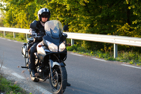 rider on a motorcycle - summer road trip on a motorbike