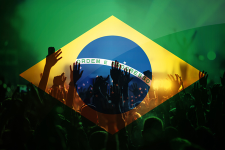 football fans supporting Brazil - double exposure of Brazil flag and crowd celebrating victory 写真素材