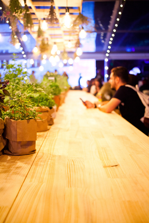 people sitting at a bar - focus on table Stock Photo