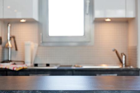 blurred kitchen interior with empty desk space