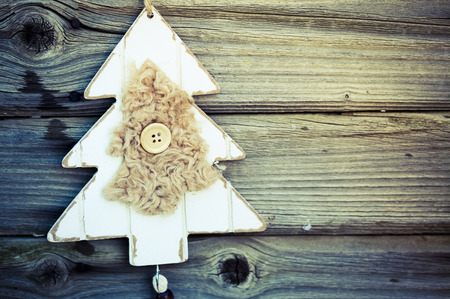 vintage wooden christmas decoration hanging - rustic holiday background