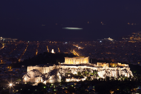 view of Athensat blue hour with the Acropolis seen from Lycabettus Hill, the highest point in the city Stock Photo