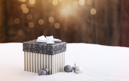 gift box in snow - christmas lights