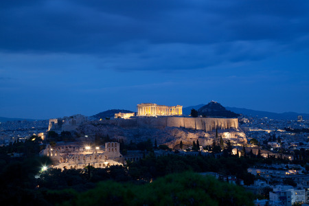 athens seen from Philopapou hill with views to Herodium , Acropolis and the Parthenon at blue hour, Attica, Greece