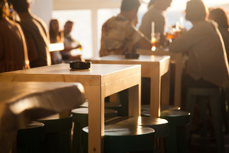 sunset bar by the beach - focus on table