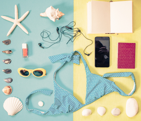 flat lay of beach holiday items: swimming suit,  sunglasses,  smartphone Stock Photo