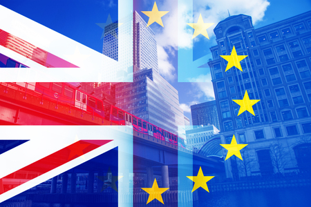 brexit concept - UK economy after Brexit deal - double exposure of flag and Canary Wharf business center skyscrapers 版權商用圖片