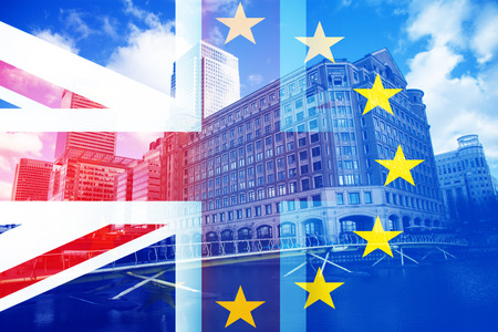 brexit concept - UK economy after Brexit deal - double exposure of flag and Canary Wharf business center skyscrapers Stok Fotoğraf