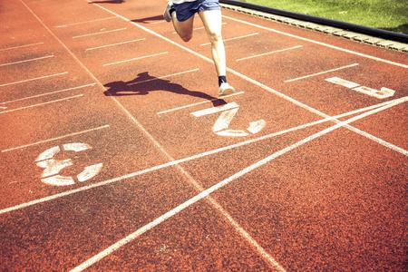 athlete on running track Stock Photo