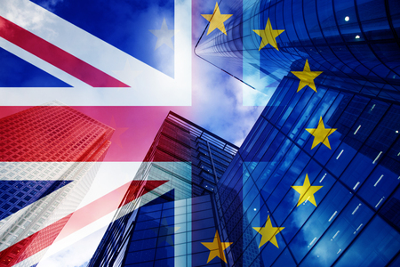 brexit concept - UK economy after Brexit deal - double exposure of flag and Canary Wharf business center skyscrapers Imagens