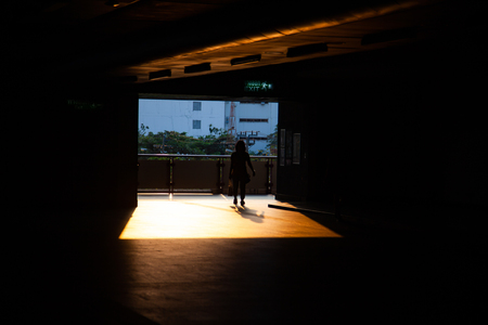 commuter silhouettes in a station in early morning Stock Photo