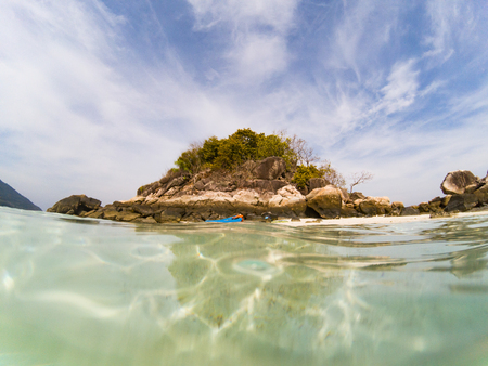 woman with a kayak on an isolated beach in Andaman sea - solo travel Stock Photo