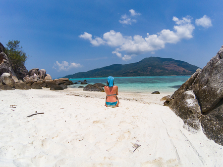 woman on an isolated beach in Andaman sea, Koh Lipe - solo travel