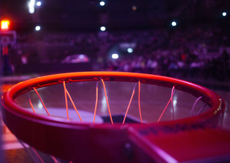 basketball hoop in red neon lights in sports arena during game - competition