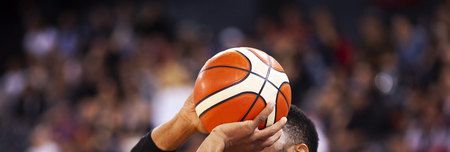 basketball player shooting three pointer during game